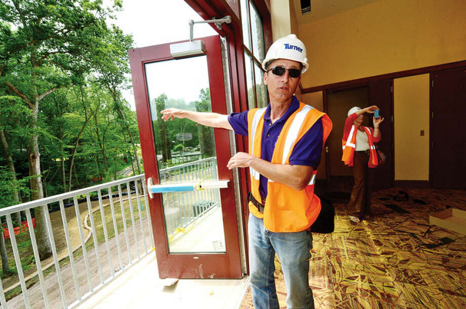 Hour photo / Erik Trautmann Westport Weston YMCA Communications Director Scott Smith leads a tour of the new Westport Weston Familty Y 54,000-square-feet facility in Westport set to open this fall.