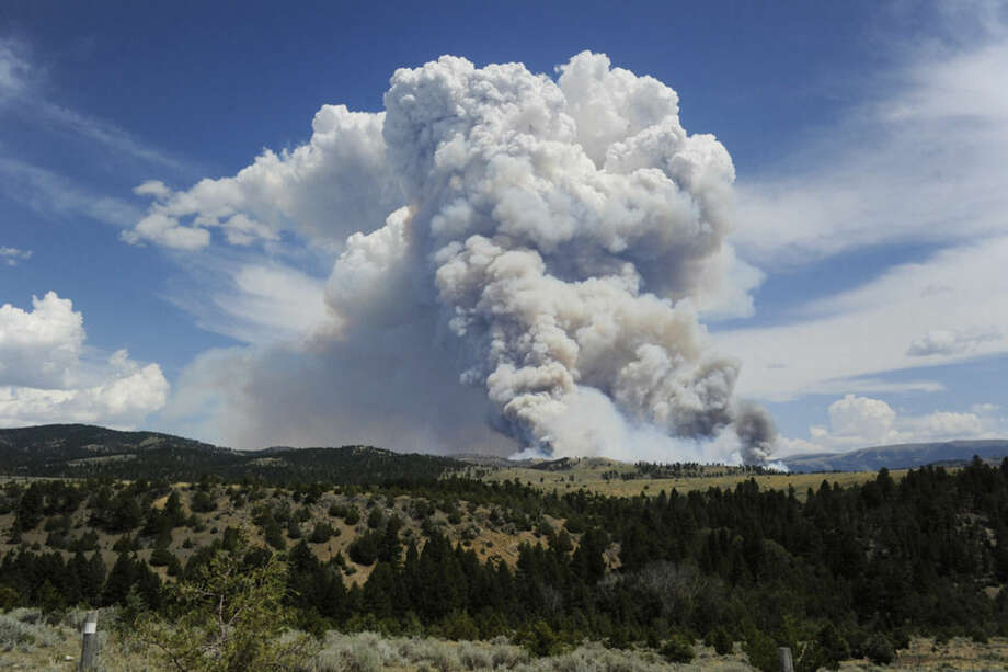 Smoke rises from a wildfire near Townsend, Mont., Tuesday, July 21, 2015. The fire has closed a portion of U.S. Highway 12 and led to evacuation orders in the rural area. (Thom Bridge/The Independent Record via AP) MANDATORY CREDIT