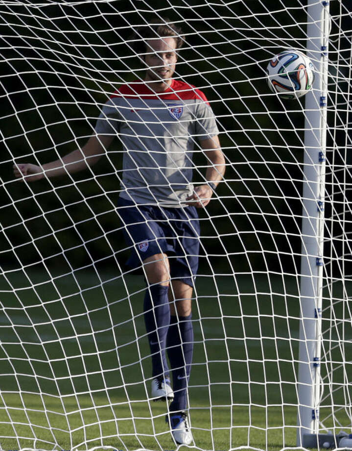 United States' Mix Diskerud kicks a ball into the net during a training session in Sao Paulo, Brazil, Monday, June 23, 2014. The United States will play Germany in group G of the 2014 soccer World Cup on June 26 in Recife, Brazil. (AP Photo/Julio Cortez)