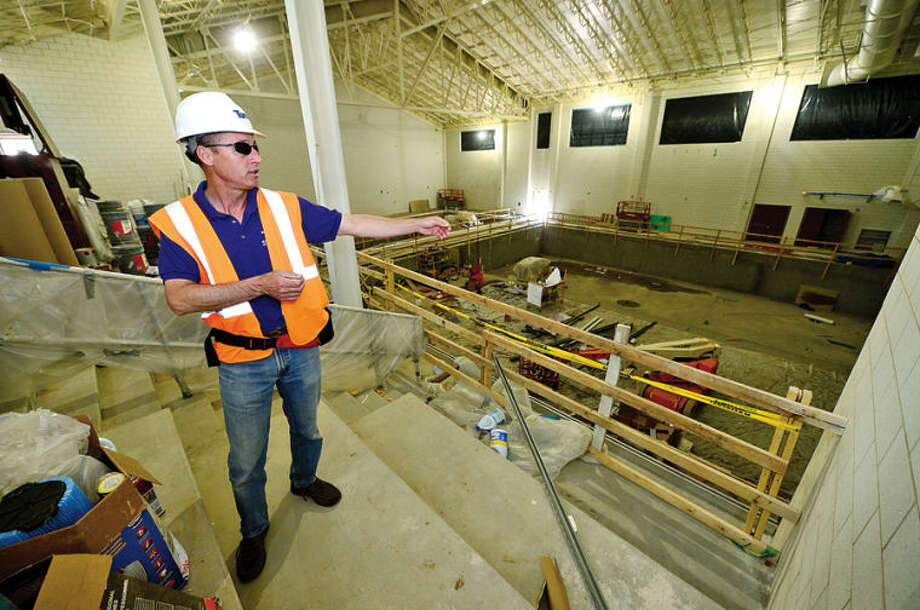 Hour photo / Erik Trautmann Westport Weston YMCA Communications Director Scott Smith leads a tour of the new Westport Weston Familty Y 54,000-square-feet facility including the Strittmatter Family Aquatic Center in Westport set to open this fall.