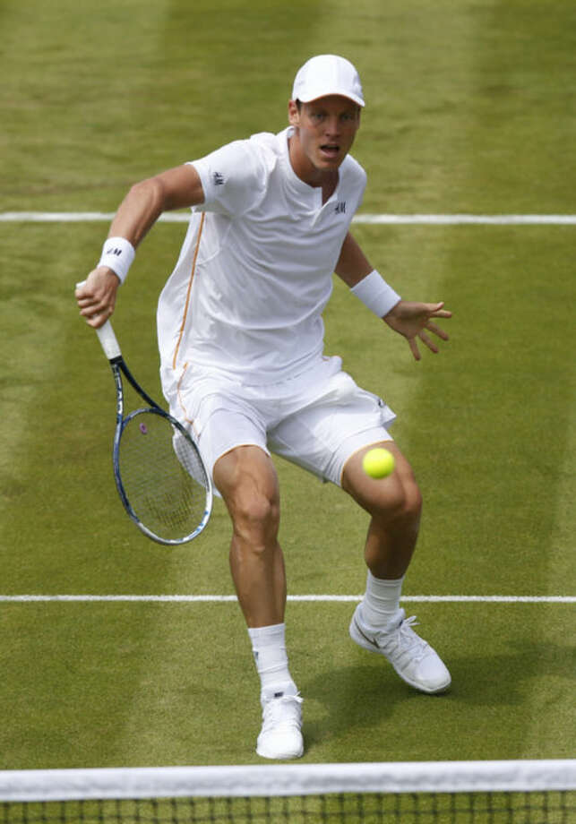 Tomas Berdych of the Czech Republic plays a return to Victor Hanescu of Romania during their first round match at the All England Lawn Tennis Championships in Wimbledon, London, Monday, June 23, 2014. (AP Photo/Sang Tan)