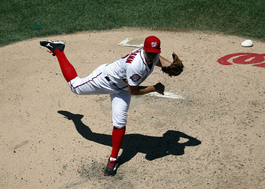 Washington Nationals starting pitcher Jordan Zimmermann (27) throws during the fifth inning of a baseball game against the New York Mets at Nationals Park, Wednesday, July 22, 2015, in Washington. (AP Photo/Alex Brandon)