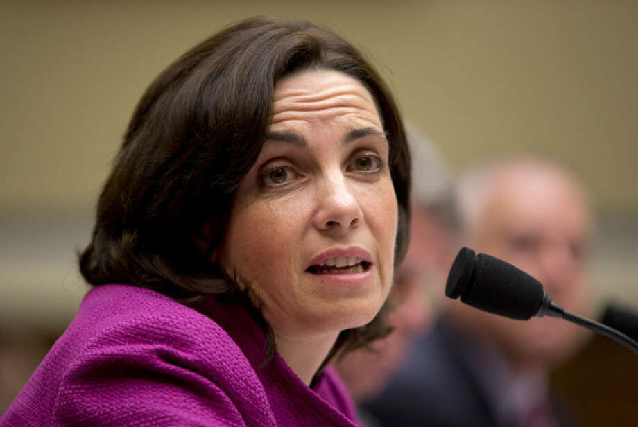 """Jennifer O'Connor of the Office of the White House Counsel, testifies on Capitol Hill in Washington, Tuesday, June 24, 2014, before the House Oversight and Government Committee hearing on """"IRS Obstruction: Lois Lerner's missing e-mails."""" (AP Photo/Manuel Balce Ceneta)"""