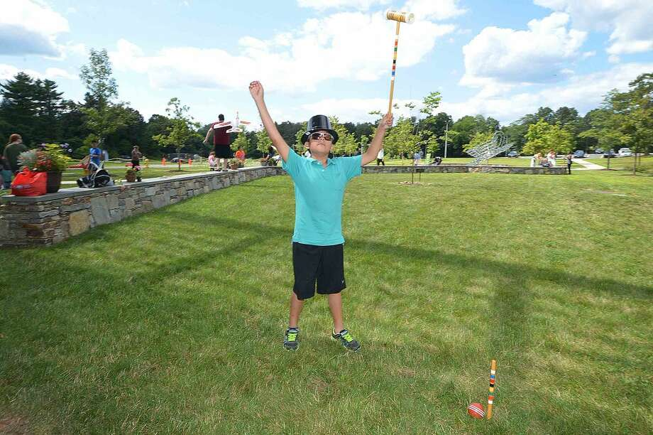 Hour Photo/Alex von Kleydorff Danny celebrates a win in a croquet match during a Roaring 20's party for the FCA after school program