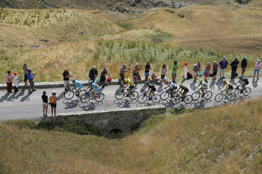 The pack with Italy's Michele Scarponi, front, Italy's Vincenzo Nibali, in second position, Britain's Chris Froome, wearing the overall leader's yellow jersey, Colombia's Nairo Quintana, wearing the best young rider's white jersey, Spain's Alejandro Valverde, fourth from right, and Spain's Alberto Contador, third from right, climbs during the seventeenth stage of the Tour de France cycling race over 161 kilometers (100 miles) with start in Digne-les-Bains and finish in Pra Loup, France, Wednesday, July 22, 2015. (AP Photo/Christophe Ena)