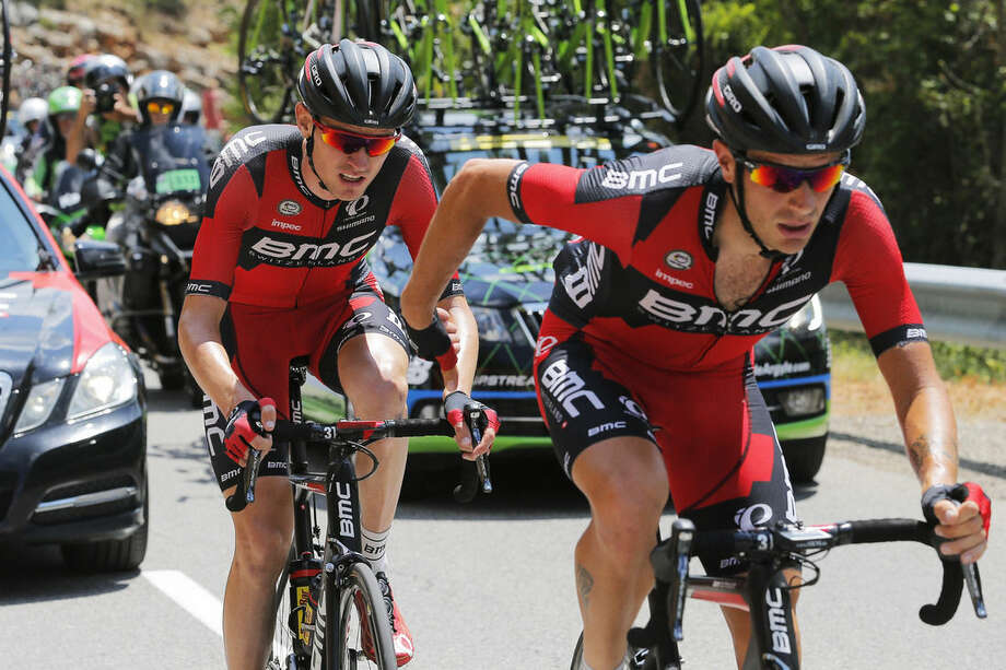 A teammate helps Tejay van Garderen of the U.S., left, after he fell ill during the seventeenth stage of the Tour de France cycling race over 161 kilometers (100 miles) with start in Digne-les-Bains and finish in Pra Loup, France, Wednesday, July 22, 2015. Van Garderen subsequently abandoned the race. (AP Photo/Christophe Ena)
