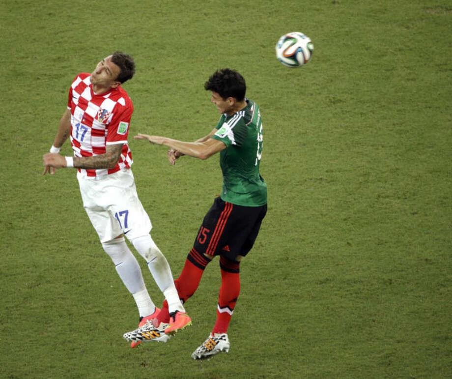 Mexico beats Croatia 3-1, advances in World Cup