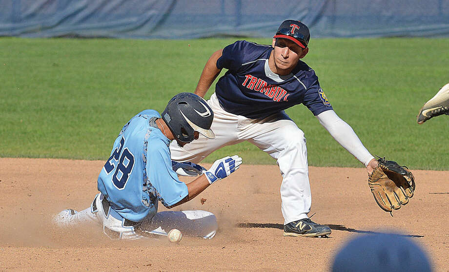 Hour Photo/Alex von Kleydorff Stamfords #28 Shawn Urbano makes it to second base safe as the throw hits him from behind vs Trumbull