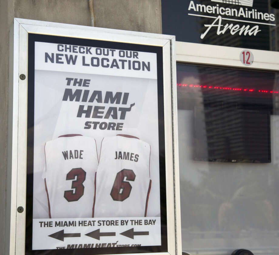 Miami Heat players Dwyane Wade and LeBron James jerseys are on display outside the American Airlines Arena in Miami, Tuesday, June 24, 2014. A person familiar with the situation tells The Associated Press that James has decided to opt out of the final two years of his contract with the Heat and become a free agent. Opting out does not mean James has decided to leave the Heat, said the person, who spoke on condition of anonymity because neither the four-time NBA MVP nor the team had made any public announcement. (AP Photo/J Pat Carter)