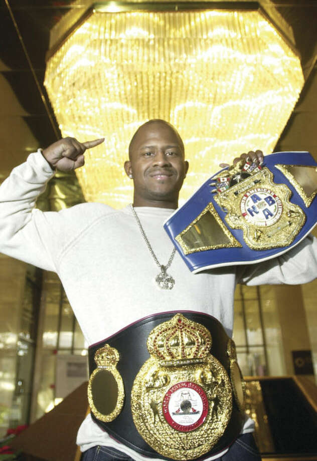 Hour file photo/Erik TrautmannNorwalk's Travis Simms displays his championship belts he won back in 2003. Simms made his return to the ring last week after a 4 1⁄2 year absence. Simms earned a unanimous six-round decision over Jess Noriega in a battle of light heavyweights in Columbia, S.C.