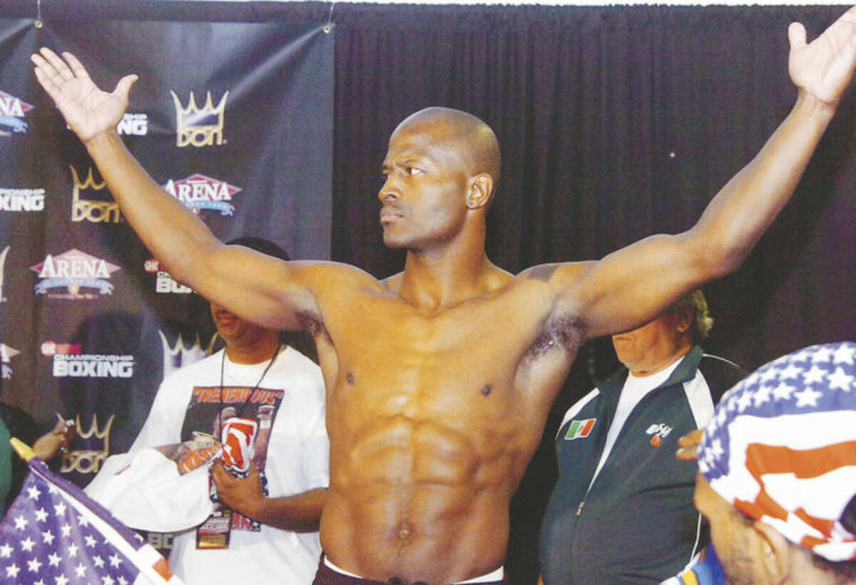 Hour file photo/Matthew Vinci Travis Simms poses during the weigh-in for his middleweight title bout at the Harbor Yard in 2007.