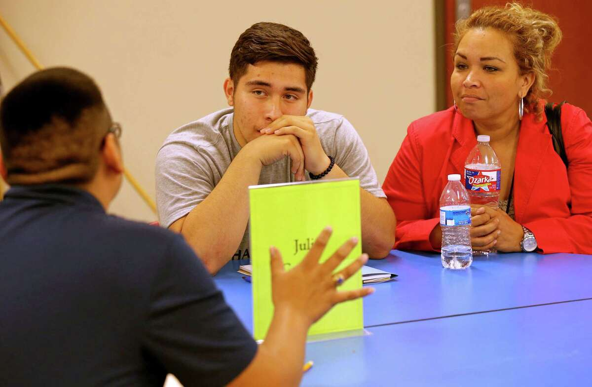 """Mentor Julio Castillejo (from left) talks with Edison High School junior Livan Hernandez, and his mother Maria Hernandez during the San Antonio Independent School District """"Students on the Rise"""" program held Thursday May 28, 2016 at Edison High School."""