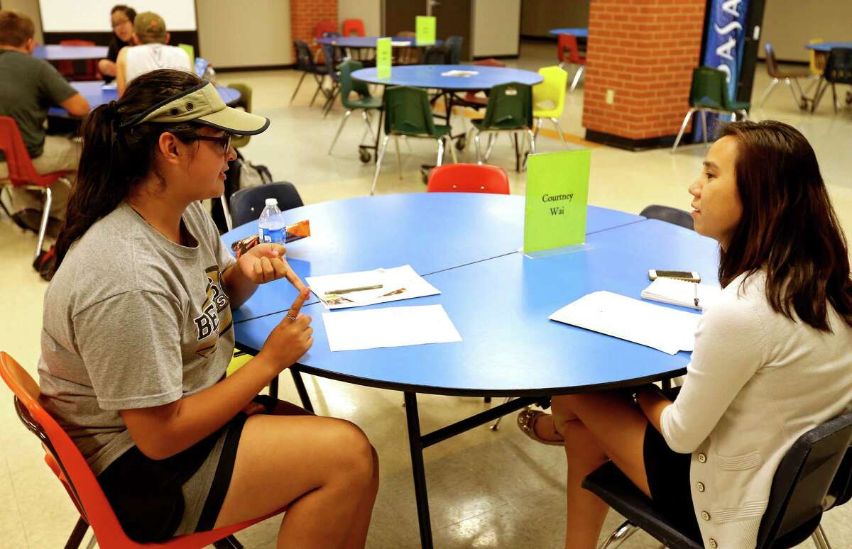 """Edison High School sophomore Jasmine Nichols (left) talks with mentor Courtney Wai during the San Antonio Independent School District """"Students on the Rise"""" program held Thursday May 28, 2016 at Edison High School."""