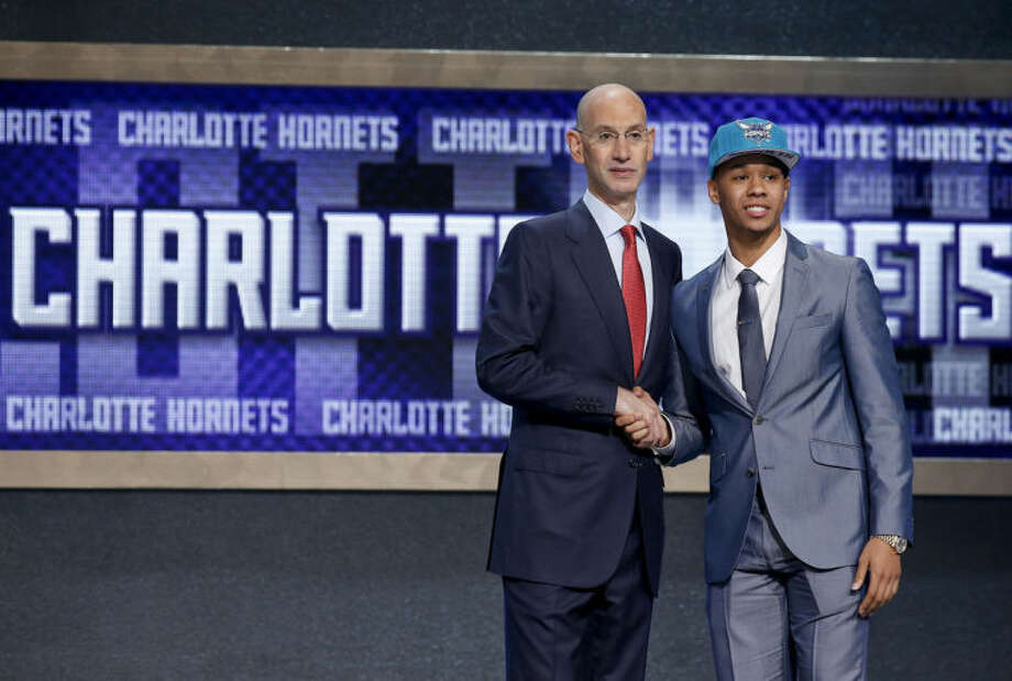 Connecticut's Shabazz Napier, right, poses for photos with NBA commissioner Adam Silver after being selected as the 24th overall pick by the Charlotte Hornets during the 2014 NBA draft, Thursday, June 26, 2014, in New York. (AP Photo/Kathy Willens)