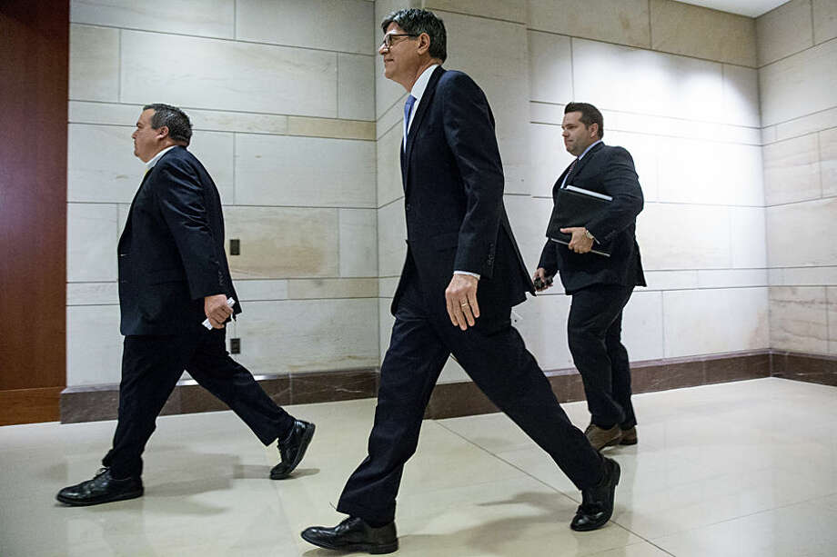 Secretary of Treasury Jacob Lew, center, arrives for a classified briefing for all House members on Capitol Hill, in Washington, Wednesday, July 22, 2015, to speak about the deal reached to curb Iran's nuclear program in exchange for billions of dollars in relief from international sanctions. (AP Photo/Andrew Harnik)
