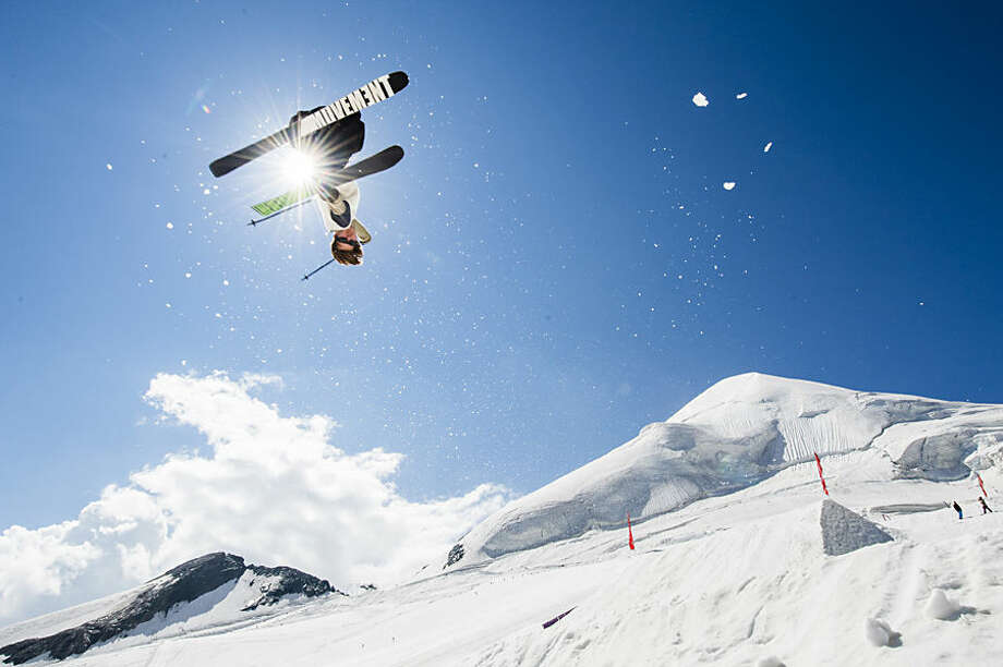 A free skier excercises on a kicker at the Freestyle Park on the Feegletscher glacier in Saas-Fee, Switzerland, Wednesday, July 22, 2015, while parts of the country experience a weeklong heat wave. (Dominic Steinmann/Keystone via AP)