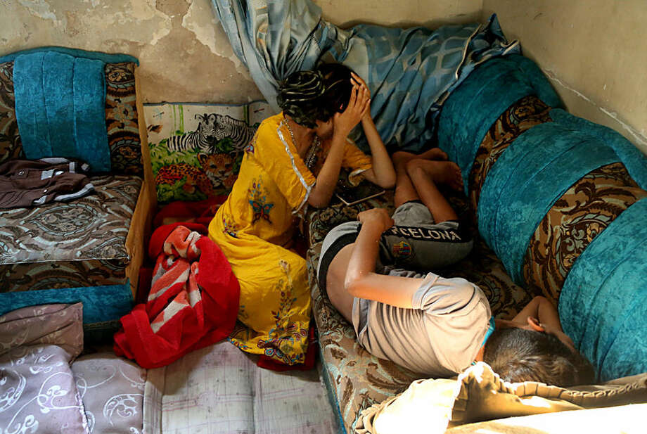Afrah Hussein, 13, grieves at her apartment near the site of a bomb attack in the aftermath of a car bomb explosion in the impoverished neighborhood of al-Bayaa in southwestern Baghdad, Iraq, Thursday, July 23, 2015. A pair of car bombs exploded Wednesday at crowded popular markets in predominantly Shiite neighborhoods of the Iraqi capital, Baghdad, killing and wounding civilians, officials said. (AP Photo/Karim Kadim)