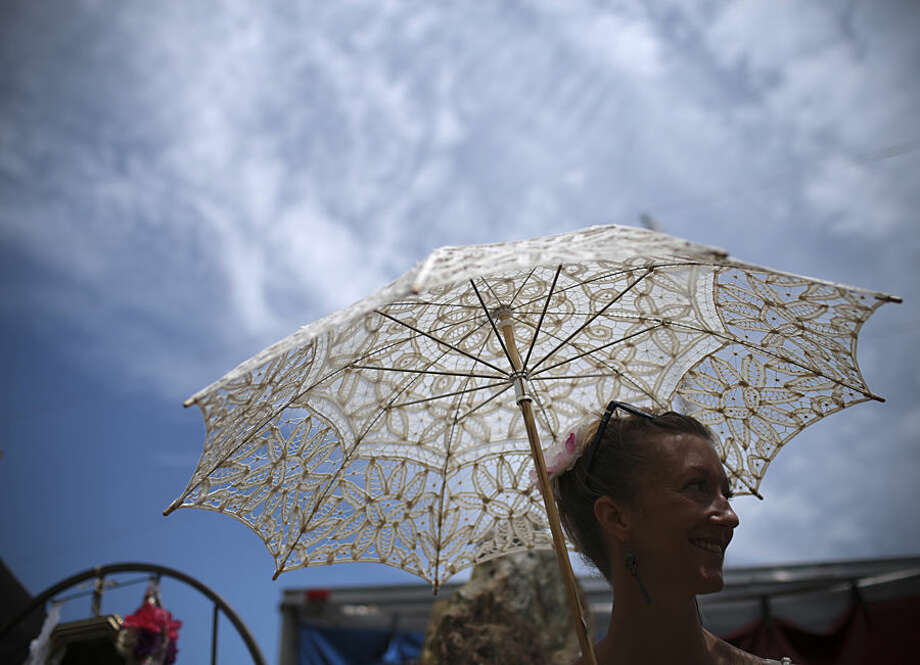 Kat Spurvey, of Floyd, Va. works a shift for Gilded Parasol during Floydfest 14, Wednesday July 22, 2015, in Floyd. The five-day festival has nine stages and is hosting nearly 75 bands. (John Roark/The Roanoke Times via AP)