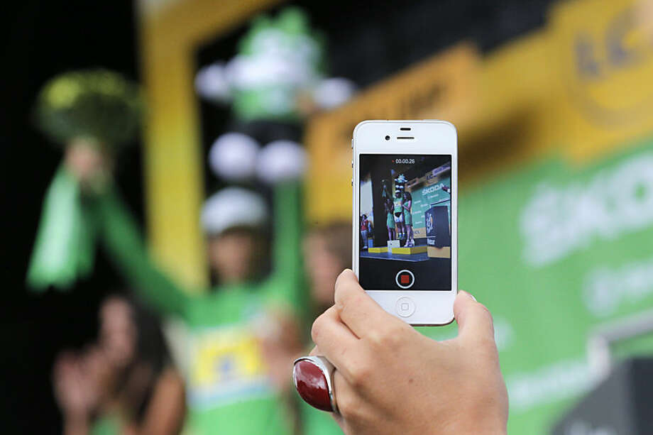 Peter Sagan of Slovakia, wearing the best sprinter's green jersey, celebrates on the podium of the seventeenth stage of the Tour de France cycling race over 161 kilometers (100 miles) with start in Digne-les-Bains and finish in Pra Loup, France, Wednesday, July 22, 2015. (AP Photo/Christophe Ena)