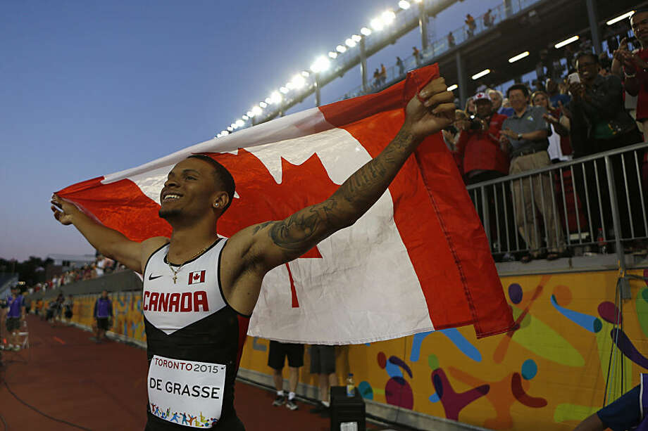 Canada's Andre de Grasse celebrates after winning the final of the men's 100m race at the Pan Am Games in Toronto, Wednesday, July 22, 2015. (AP Photo/Rebecca Blackwell)