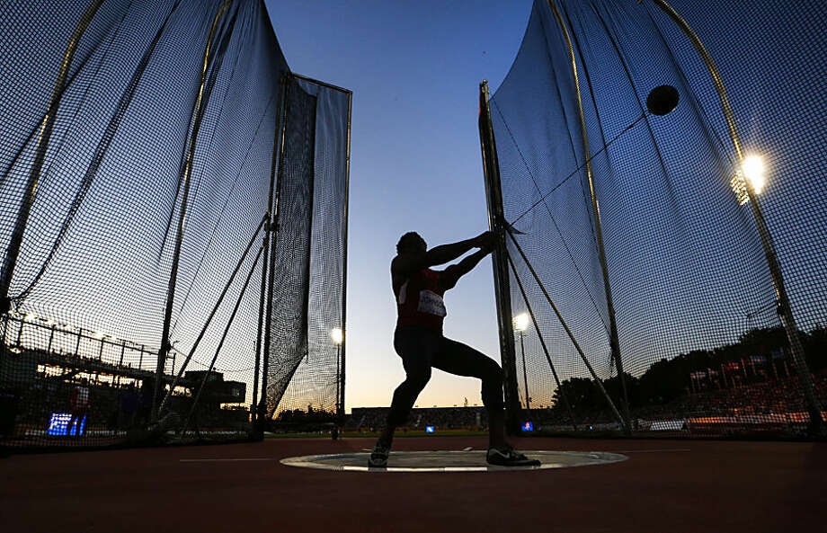 USA's Kibwe Johnson competes his way to winning the gold medal in men's hammer throw during the athletics at the Pan Am Games in Toronto, Wednesday July 22, 2015. (Mark Blinch/The Canadian Press via AP)