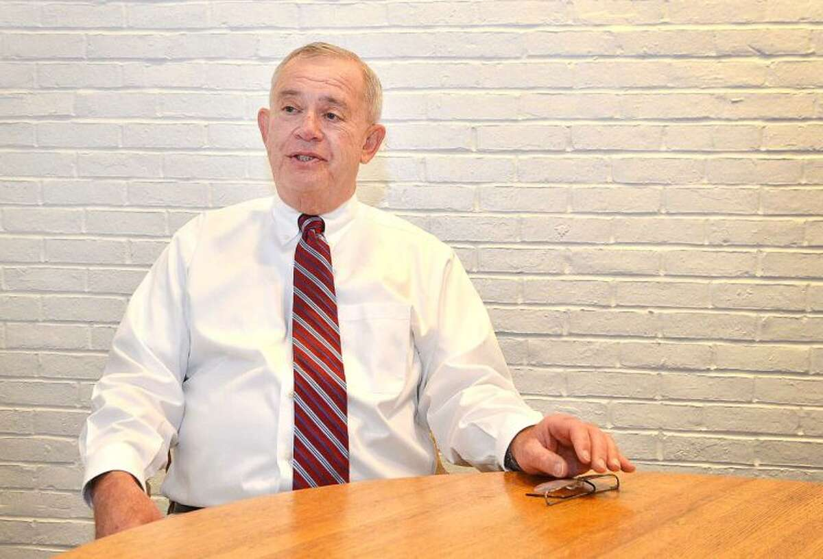Phil Sharlach will challenge state Sen. Toni Boucher for her seat in the General Assembly.