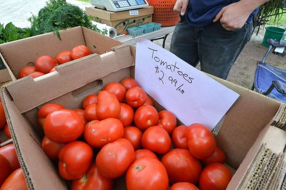Beautiful ripe tomatoes offerd at Gazy Brothers Farm from Oxford at Wiltons Farmers Market.