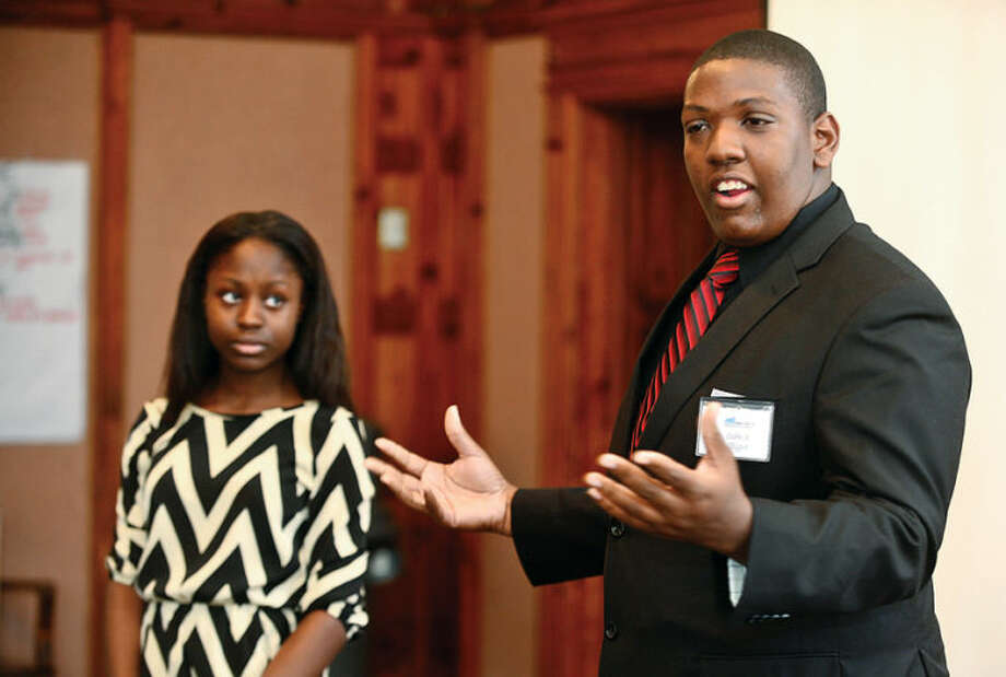 Hour photo / Erik Trautmann Graduates Cedric Thypen and Maya Simms speak during the graduation ceremony for the paricipants in the Mayor's Summer Youth Employment Program Friday at City Hall.