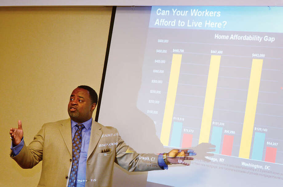 Hour photo / Erik Trautmann The Greater Norwalk Chamber of Commerce hosts 'A Business Discussion on Housing Our Workforce' with APD CEO Vaugn Irons on Friday at the Hilton Garden Inn Norwalk.