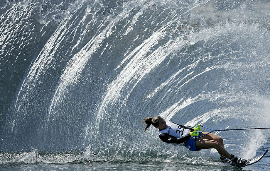 The United States' Regina Jaquess skis during the slalom portion of the women's overall water ski competition in the Pan Am Games in Toronto Wednesday, July 22, 2015. (AP Photo/Gregory Bull)
