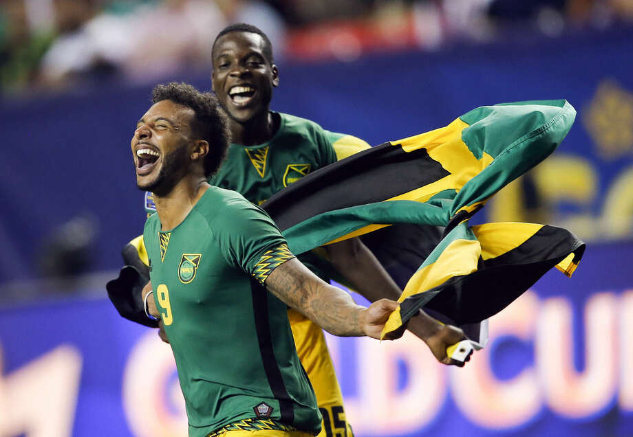 Jamaica's Giles Barnes (9) and Je-Vaughn Watson (15) celebrate after Jamaica defeated the United States 2-1 in a CONCACAF Gold Cup soccer semifinal, Wednesday, July 22, 2015, in Atlanta. (AP Photo/John Bazemore)
