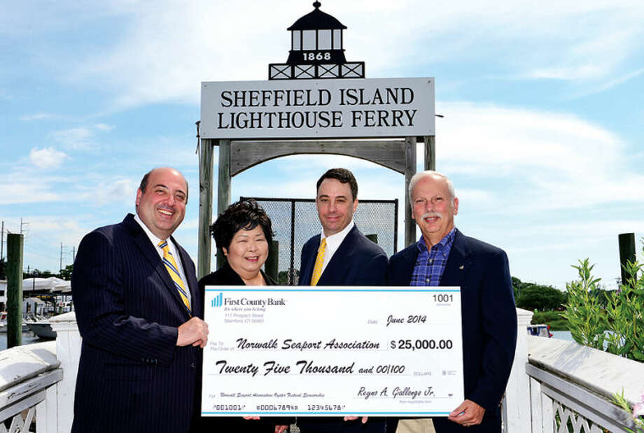 Hour photo / Erik Trautmann First County Bank COO Robert Granata, Norwalk Seaport Association president Irene Dixon and trustee Mike Reilly and First County Bank CEO Reyno Giallongo announce the banks's continued sponsorship of the annual Norwalk Seaport Association's Oyster Festival