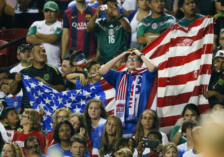 U.S. soccer fans watch during the final moments of the team's CONCACAF Gold Cup soccer semifinal against Jamaica on Wednesday, July 22, 2015, in Atlanta. Jamaica won 2-1. (AP Photo/John Bazemore)