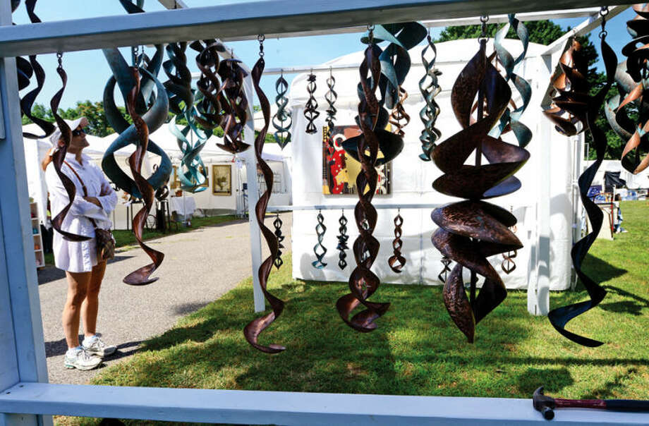 Hour photo / Erik Trautmann Metal scupture by Craig Riches is displayed during the 2nd annual Norwalk Art Festival at Mathews Park Saturday.