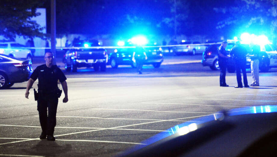 Law enforcement and other emergency personnel respond to the scene of a shooting at the Grand Theatre on Thursday, July 23, 2015, in Lafayette, La. (Leslie Westbrook/The Advocate via AP)