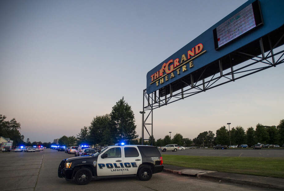 A Lafayette Police Department vehicle blocks an entrance at the Grand Theatre in Lafayette, La., following a shooting, Thursday, July 23, 2015. (Paul Kieu/The Daily Advertiser via AP)