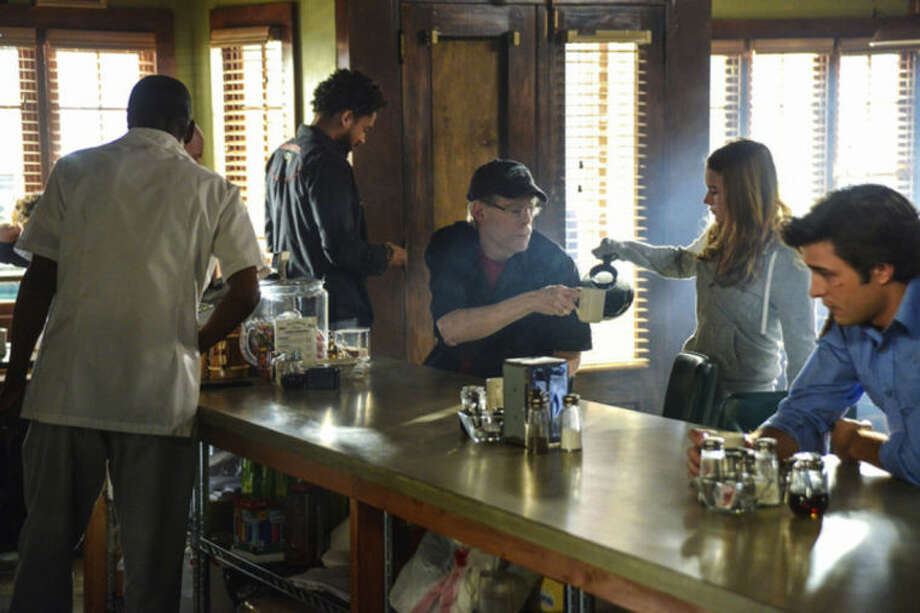 """This photo released by CBS shows, from left, Nicholas Strong as Phil Bushey, Stephen King, Britt Robertson as Angie McAlister, and Alexander Koch as Junior Rennie, in a scene from the episode """"Heads Will Roll"""" in the second season premiere of """"Under the Dome,"""" Monday, June 30, 2014, (10:00-11:00 PM, ET/PT) on the CBS Television Network. (AP Photo/CBS, Brownie Harris) **NO SALES NO ARCHIVE. NORTH AMERICA USE ONLY MANDATORY CREDIT. **"""