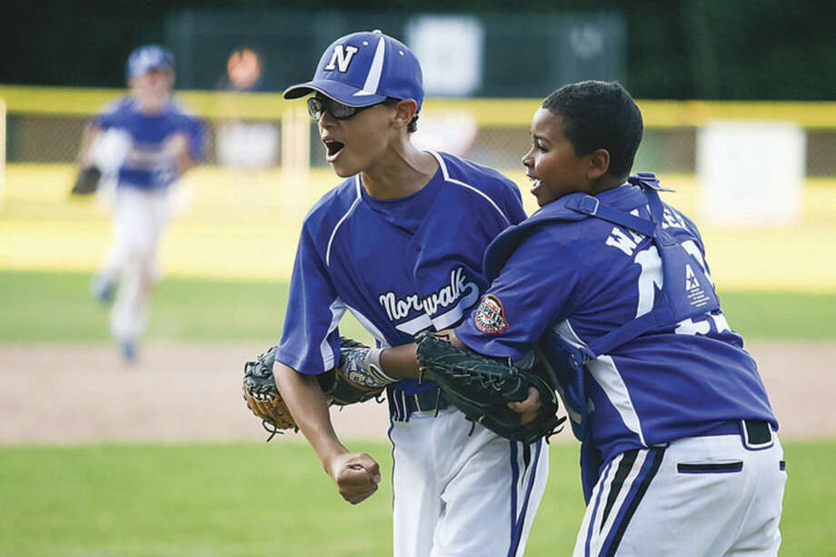 Hour photo/Chris PalermoNorwalk's Jeremy Cooke, left, and Kam Walker celebrate after their team's 9-8 win over Stratford in the Ripken 11-year-old state winner's bracket final on Thursday evening at Tim Devine Field.