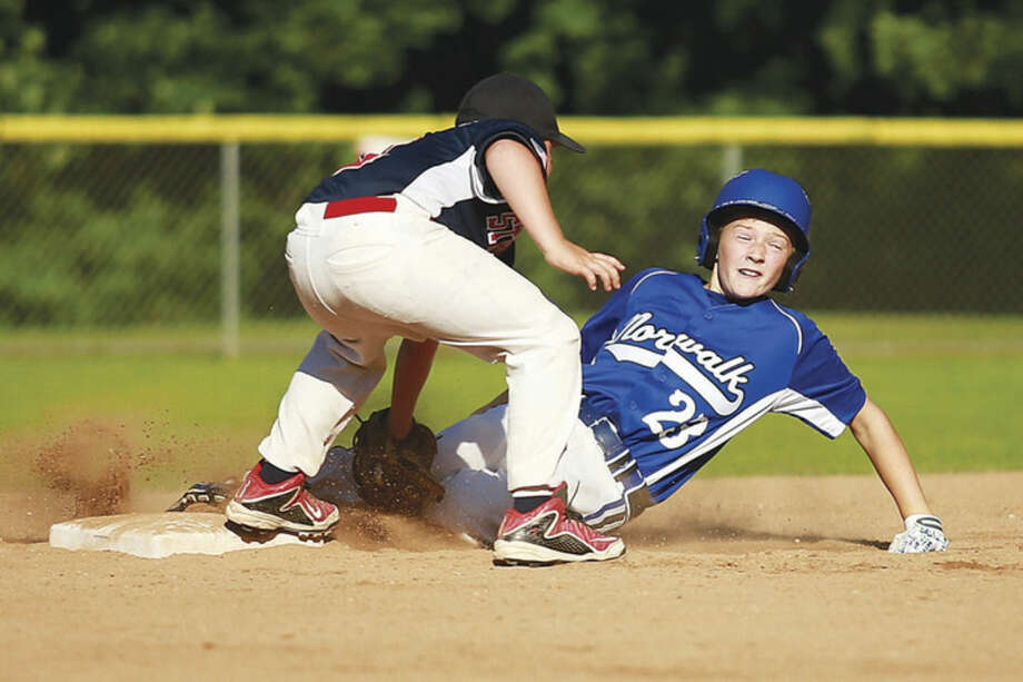 Hour photo/Chris PalermoNorwalk's Kyle Root looks toward the umpire after sliding into second base during his team's winner's bracket game against Stratford on Thursday evening at Tim Devine Field. Norwalk advanced to the state championship game with a 9-8 victory over Stratford.