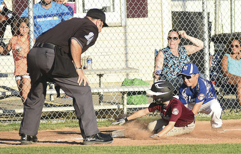 Hour photo/John NashUnder the watchful eye of the umpire, Norwalk 9-year-old All-Star third baseman Justin Feinstein, right, tags out West Hartford's Tommy Baldini during Thursday's Cal Ripken state championship game at Francis Field in Milford. Norwalk posted an 8-2 victory.
