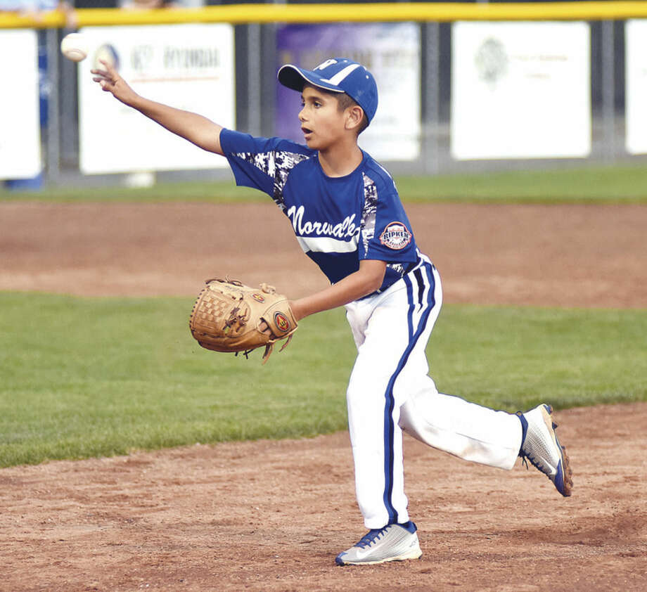 Hour photo/John NashNorwalk 9s second baseman Taso Panagiotidis comes up throwing on a ground ball during Thursday's Cal Ripken state championship game against West Hartford at Francis Field in Milford.
