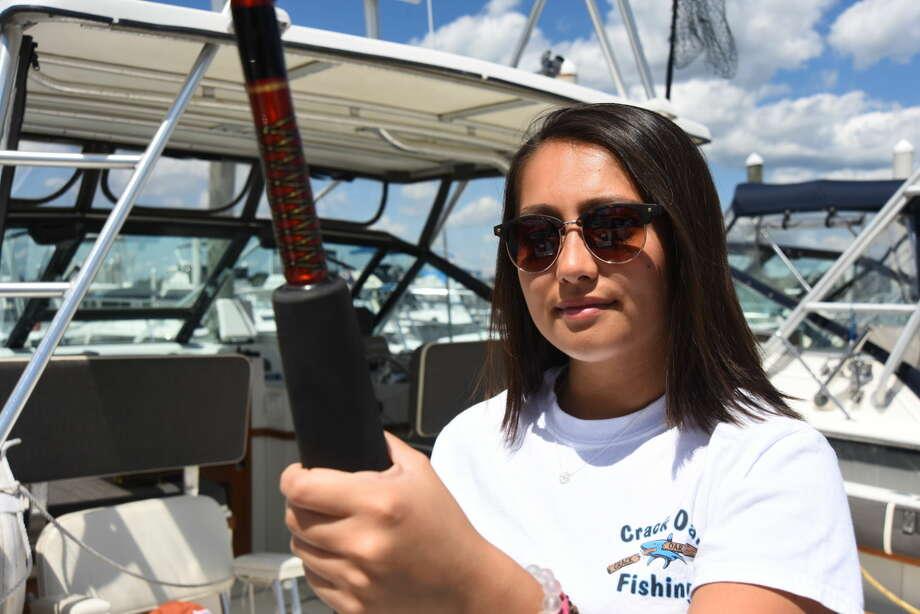 Former Norwalk High girls lacrosse player Sabrina Hiller caught seven sharks during a recent tournament in Rhode Island.