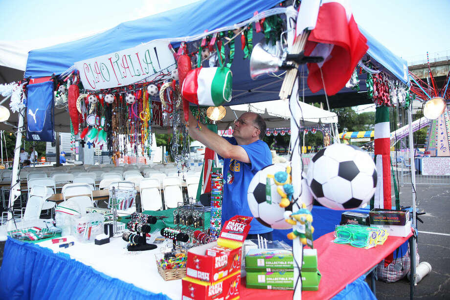 Dan Kay from Ciao Italia, sets up his stand during the annual St. Ann Festival in Norwalk Friday afternoon. Hour Photo / Danielle Calloway