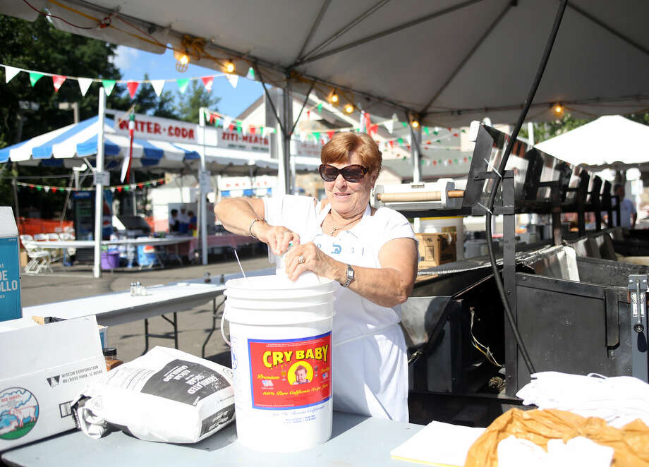 Mary Ann Cappuccia prepares sugar for the Pizza Fritta during the annual St. Ann Festival in Norwalk Friday afternoon. Hour Photo / Danielle Calloway