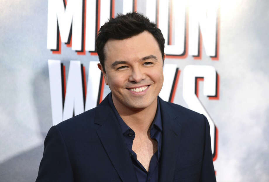 "FILE - This May 15, 2014 file photo shows actor Seth MacFarlane at the World Premiere of ""A Million Ways To Die In The West"" in Westwood, Calif. MacFarlane has agreed to match up to $1 million in contributions to the Reading Rainbow Kickstarter fundraising campaign by LeVar Burton that ends July 2. Burton's goal of raising $1 million by July 2 was reached within hours of the campaign's May launch, according to the website. (Photo by Jordan Strauss/Invision/AP, File)"