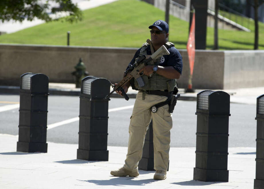 A U.S. Marshall stands guard outside of the federal U.S. District Court in Washington Saturday, June 28, 2014, after security outside the court was heightened in anticipation of a possible court appearance by captured Libyan militant Ahmed Abu Khattala later in the day. Khatallah is one of the men accused in the deadly Benghazi attack at the U.S. embassy in Libya. He faces criminal charges in the deaths of the US ambassador to Libya and three other Americans from the Sept. 11, 2012, attack. (AP Photo/Jose Luis Magana)