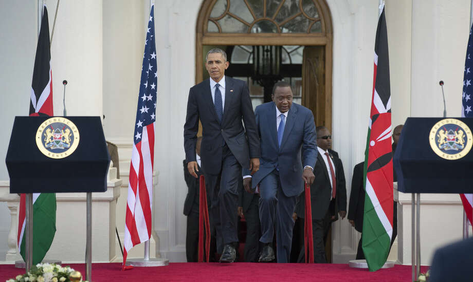 President Barack Obama, left, and Kenya's President Uhuru Kenyatta, right, arrive to speak to the media after meeting together at State House in Nairobi, Kenya Saturday, July 25, 2015. (AP Photo/Ben Curtis)