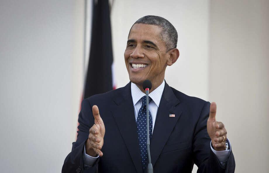 President Barack Obama answers questions from the media, after meeting with Kenya's President Uhuru Kenyatta, at State House in Nairobi, Kenya Saturday, July 25, 2015. (AP Photo/Ben Curtis)
