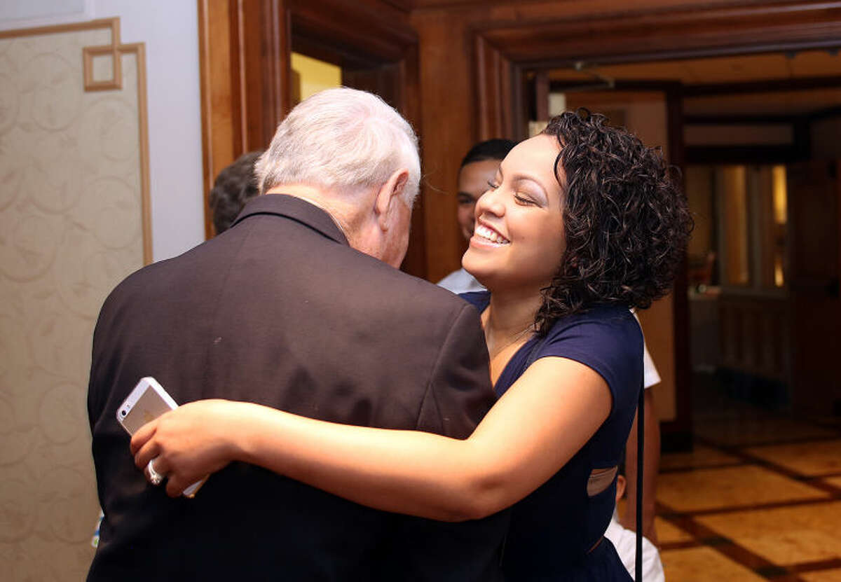 Nyla Torres is welcomed by Sponsor George Bauer during Norwalk?•s I Have a Dream Foundation's ceremony to celebrate the achievements of Washington Village students who completed the program and graduated high school and college at the Norwalk Inn Saturday evening. Hour Photo / Danielle Calloway