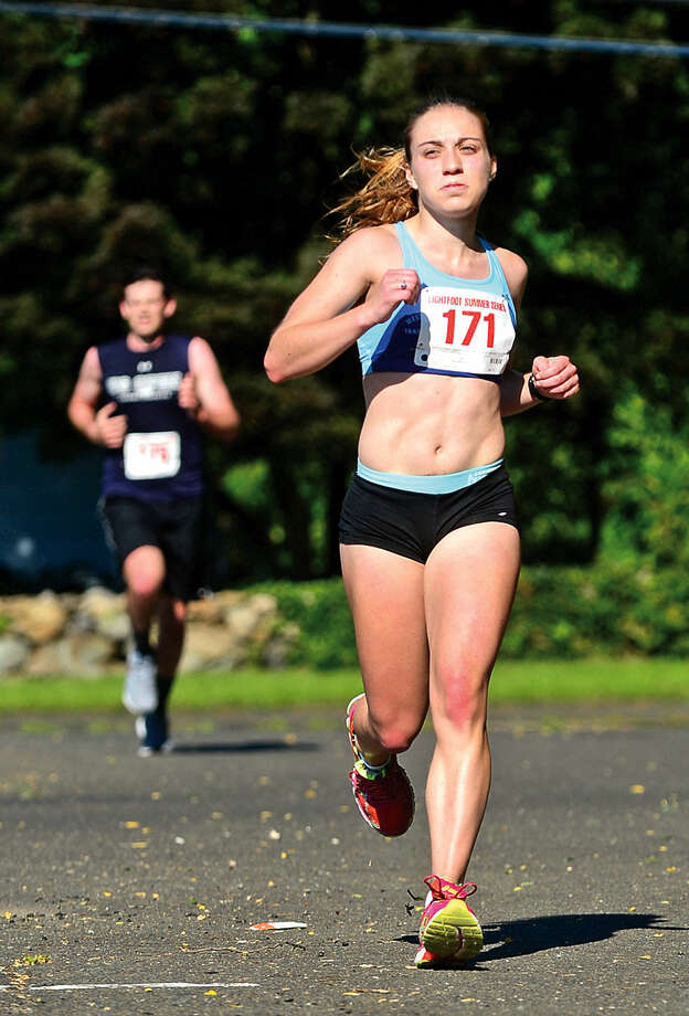 Hour photo / Erik Trautmann Lindsey Russo is the first woman to finish in the Norwalk Lightfoot 7-mile road race at Brien McMahon High School Saturday.